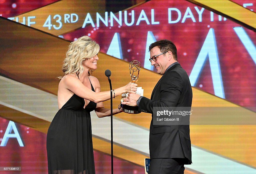 Actress Laura Wright (L) presents Emmy award for Outstanding Lead Actor in a Drama to Actor Tyler Christopher onstage at the 43rd Annual Daytime Emmy Awards at the Westin Bonaventure Hotel on May 1, 2016 in Los Angeles, California.