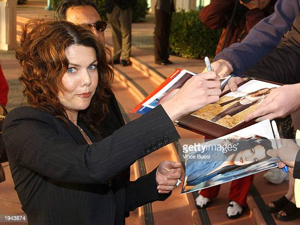 Actress Lauren Graham signs autographs at a behind the scenes discussion of the television show 'Gilmore Girls' at the Academy of Television Arts and...