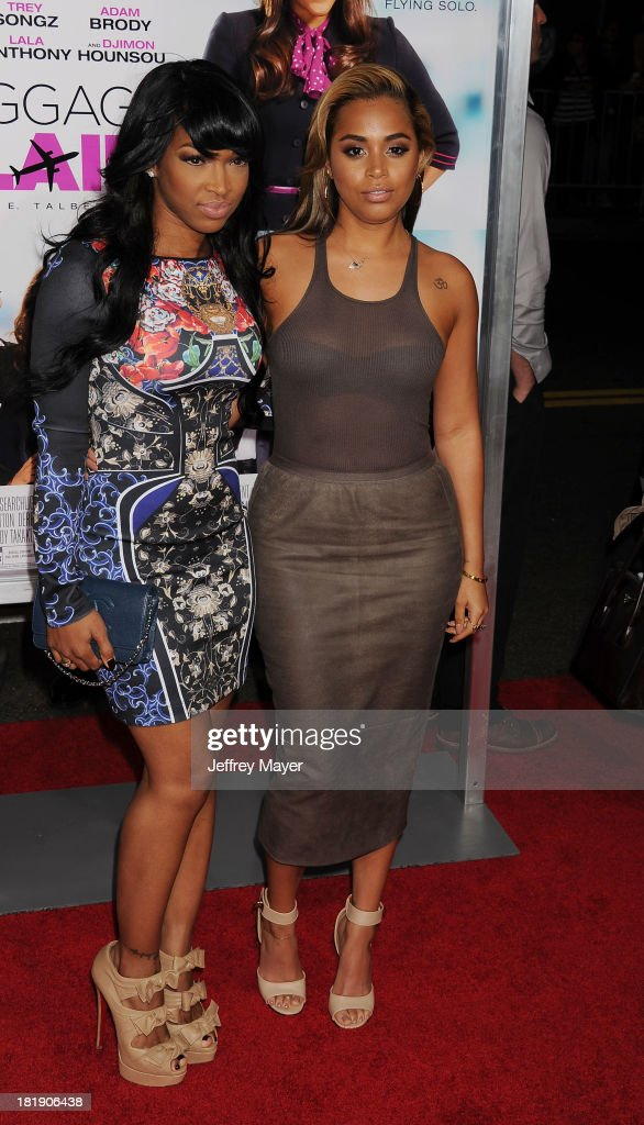 Actress Lauren London (R) and guest arrive at the Los Angeles premiere of 'Baggage Claim' at Regal Cinemas L.A. Live on September 25, 2013 in Los Angeles, California.