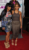 Actress Lauren London and guest arrive at the Los Angeles premiere of 'Baggage Claim' at Regal Cinemas LA Live on September 25 2013 in Los Angeles...