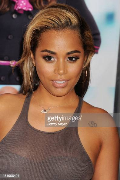 Actress Lauren London arrives at the Los Angeles premiere of 'Baggage Claim' at Regal Cinemas LA Live on September 25 2013 in Los Angeles California