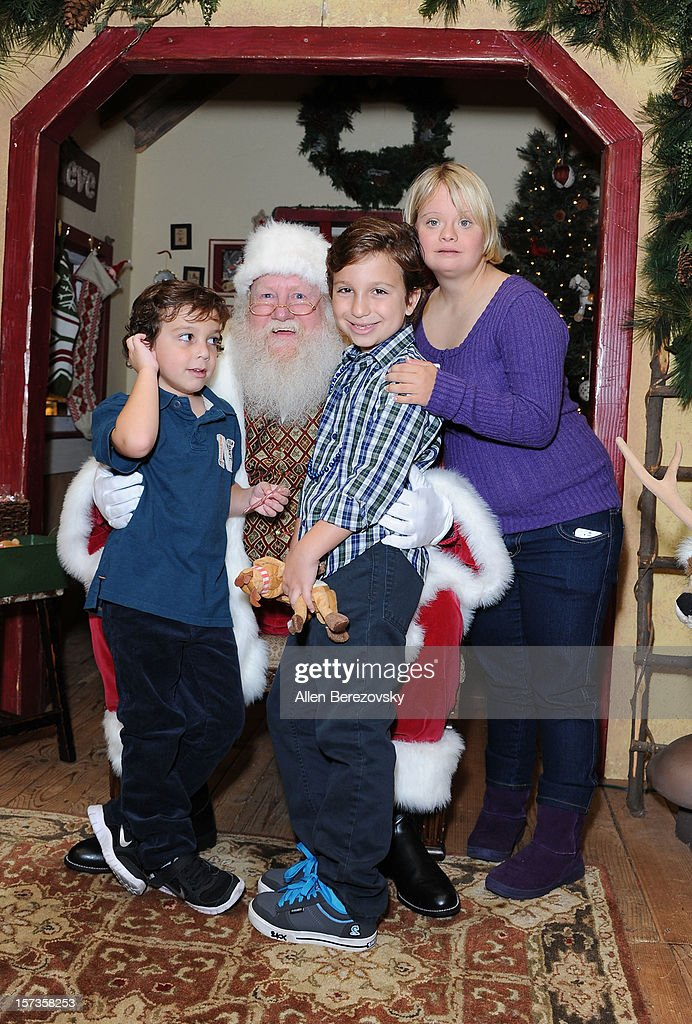 Actress Lauren Potter (R) poses with Santa Claus and kids with special needs at the Westminster Mall's Caring Santa event on December 2, 2012 in Westminster, California.