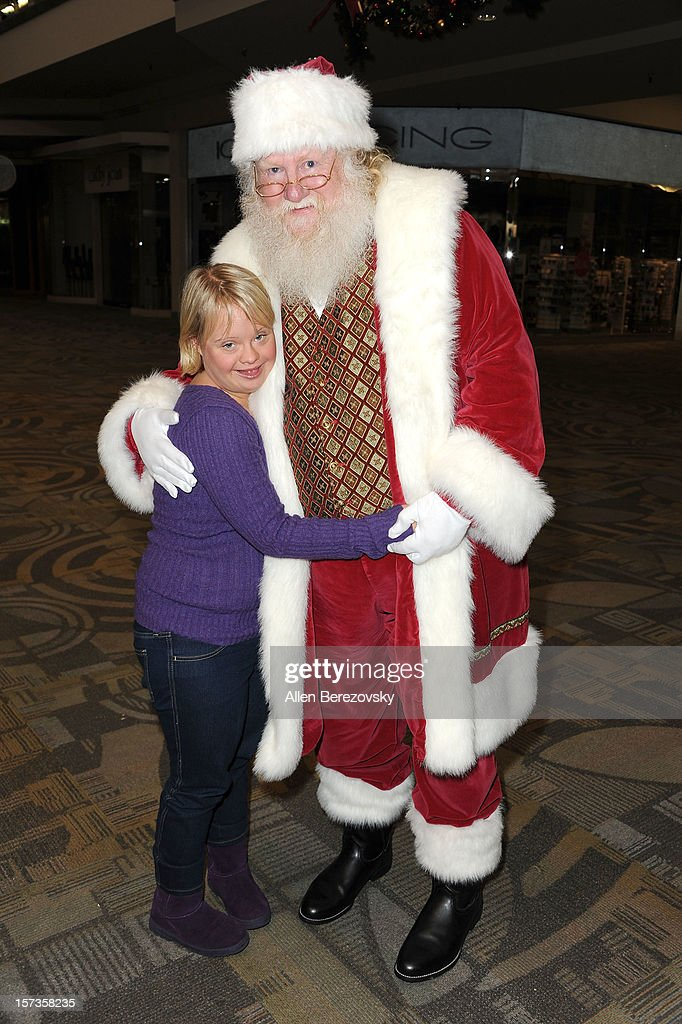Actress <a gi-track='captionPersonalityLinkClicked' href=/galleries/search?phrase=Lauren+Potter&family=editorial&specificpeople=7243163 ng-click='$event.stopPropagation()'>Lauren Potter</a> poses with Santa Claus at the Westminster Mall's Caring Santa event on December 2, 2012 in Westminster, California.