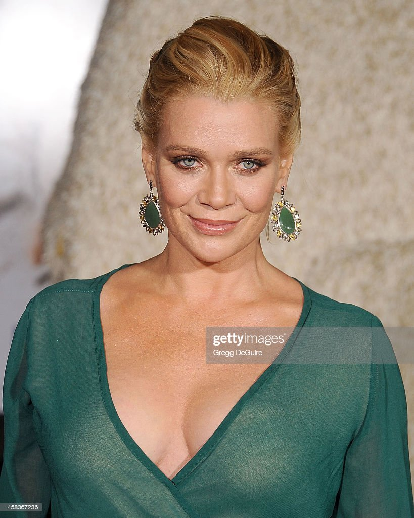 Actress Laurie Holden arrives at the Los Angeles premiere of 'Dumb And Dumber To' at Regency Village Theatre on November 3, 2014 in Westwood, California.