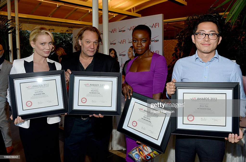 Actress <a gi-track='captionPersonalityLinkClicked' href=/galleries/search?phrase=Laurie+Holden&family=editorial&specificpeople=678388 ng-click='$event.stopPropagation()'>Laurie Holden</a>, producer Gregory Nicotero, actress Danai Gurira, and actor Steven Yeun attend the 13th Annual AFI Awards at Four Seasons Los Angeles at Beverly Hills on January 11, 2013 in Beverly Hills, California.