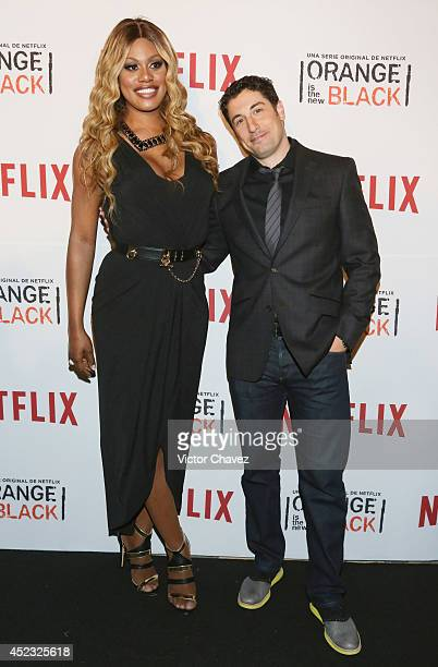 Actress Laverne Cox and actor Jason Biggs attend the Orange Is The New Black second season red carpet at Fotomuseo Cuatro Caminos on July 17 2014 in...