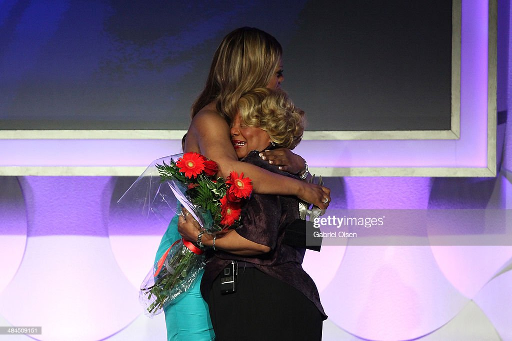Actress <a gi-track='captionPersonalityLinkClicked' href=/galleries/search?phrase=Laverne+Cox&family=editorial&specificpeople=5848606 ng-click='$event.stopPropagation()'>Laverne Cox</a> (L) and mother onstage during the 25th Annual GLAAD Media Awards at The Beverly Hilton Hotel on April 12, 2014 in Beverly Hills, California.