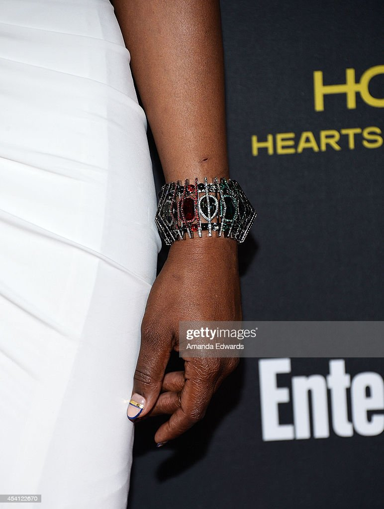 Actress Laverne Cox (bracelet and manicure detail) arrives at the 2014 Entertainment Weekly Pre-Emmy Party at Fig & Olive Melrose Place on August 23, 2014 in West Hollywood, California.