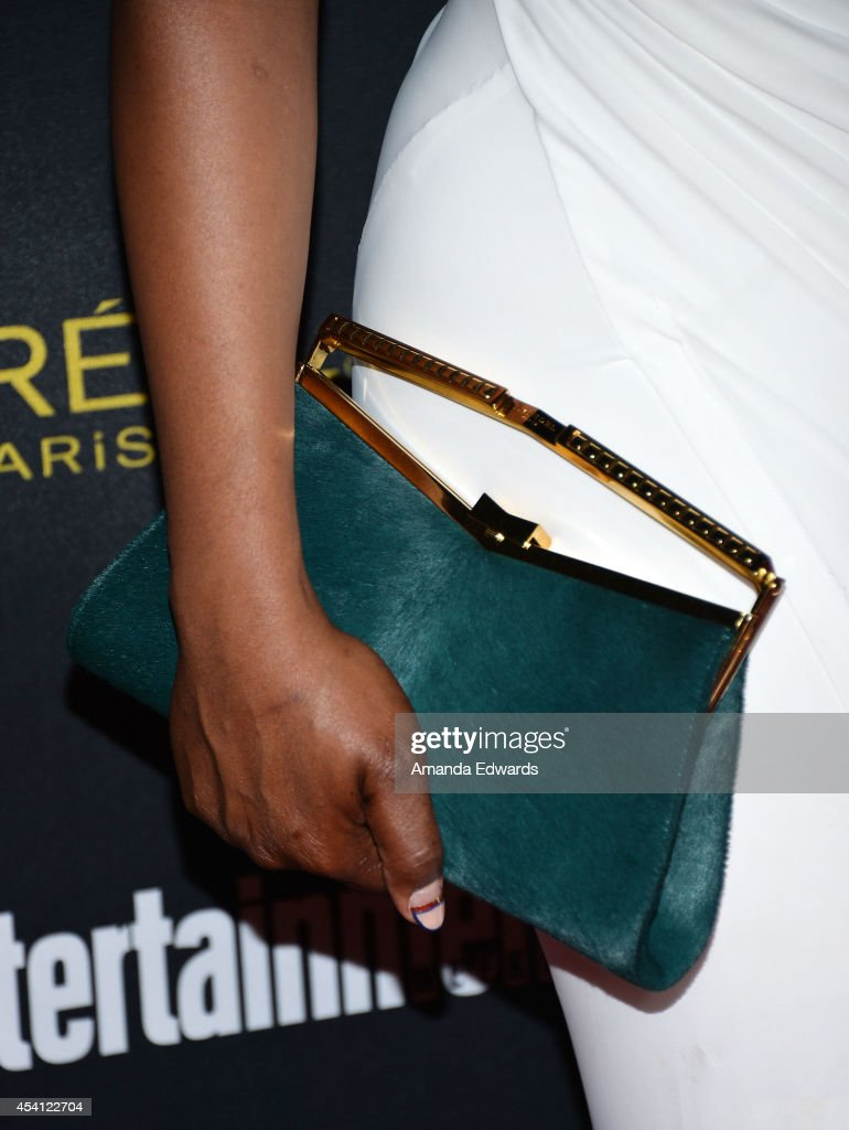 Actress Laverne Cox (clutch and manicure detail) arrives at the 2014 Entertainment Weekly Pre-Emmy Party at Fig & Olive Melrose Place on August 23, 2014 in West Hollywood, California.