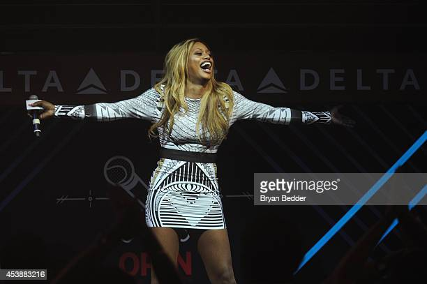 Actress Laverne Cox sings onstage at the Delta OPEN Mic a private karaoke event in celebration of Serena Williams' upcoming defending tennis...
