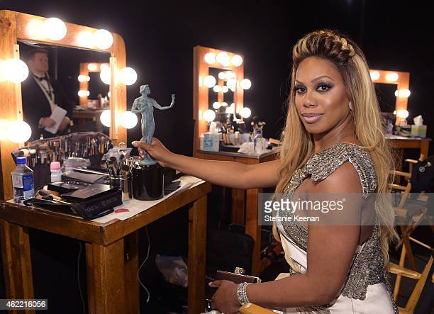 Actress Laverne Cox winner of the award for Outstanding Performance by an Ensemble in a Comedy Series for 'Orange is the New Black' attends TNT's...