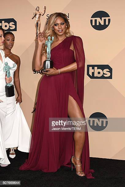 Actress Laverne Cox winner of the award for Outstanding Performance by an Ensemble in a Comedy Series for 'Orange Is the New Black' poses in the...