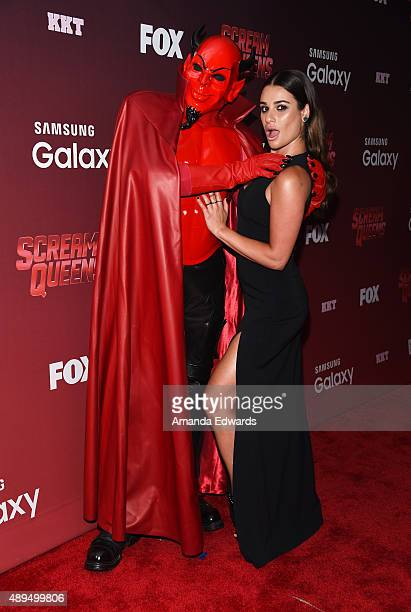 Actress Lea Michele and Red Devil arrive at the premiere of FOX TV's 'Scream Queens' at The Wilshire Ebell Theatre on September 21 2015 in Los...