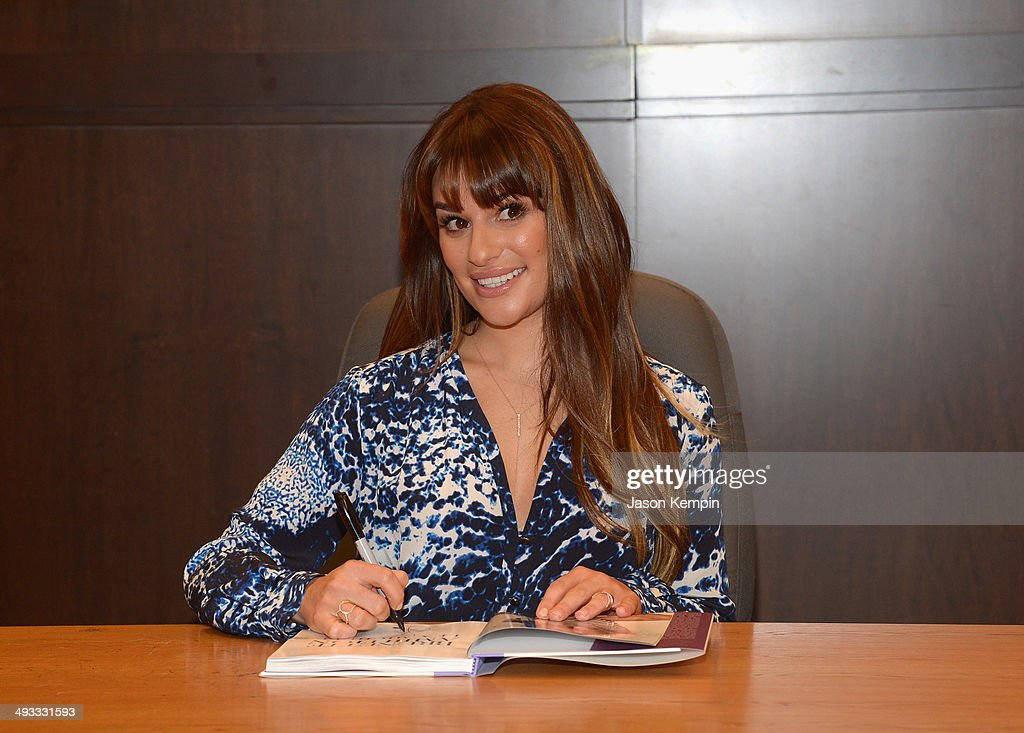 Actress <a gi-track='captionPersonalityLinkClicked' href=/galleries/search?phrase=Lea+Michele&family=editorial&specificpeople=566514 ng-click='$event.stopPropagation()'>Lea Michele</a> signs copies of her new book 'Brunette Ambition' at Barnes & Noble bookstore at The Grove on May 22, 2014 in Los Angeles, California.