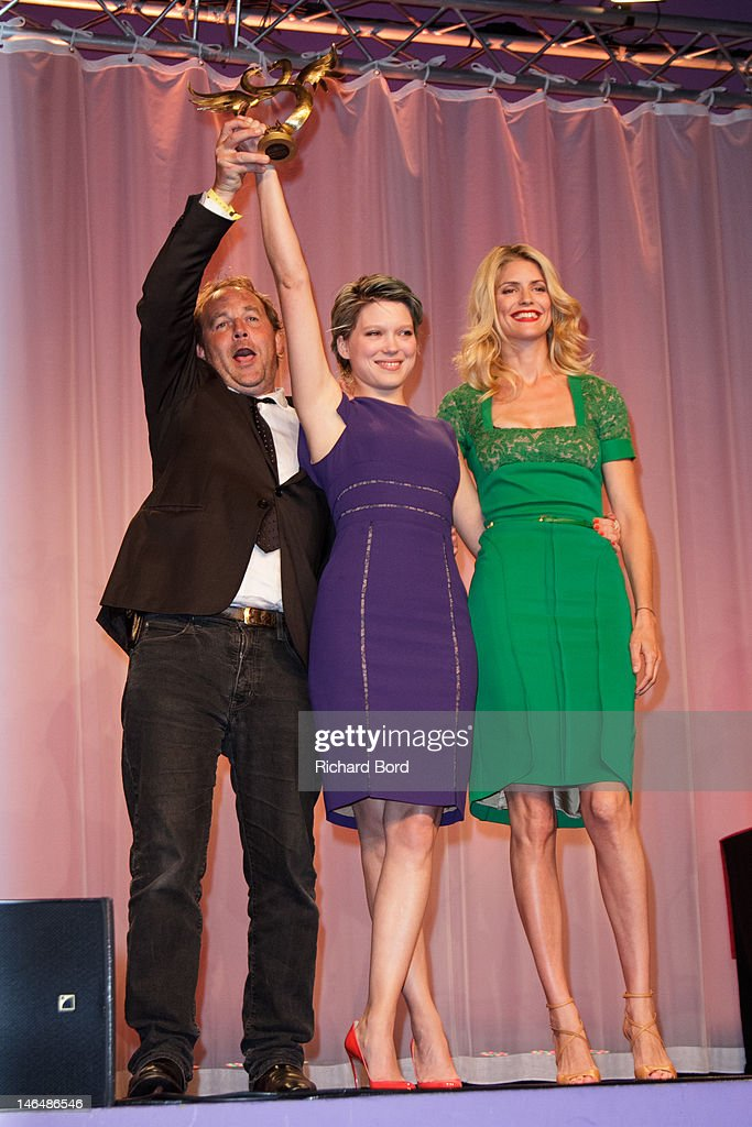 Actress Lea Seydoux (C) is awarded 'Swann d'Or' Best Actress by Xavier Beauvois (L) and Alice Taglioni (R) during 26th Cabourg Romantic Film Festival on June 16, 2012 in Cabourg, France.