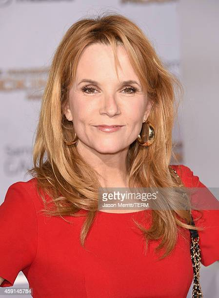 Actress Lea Thompson attends the Premiere of Lionsgate's 'The Hunger Games Mockingjay Part 1' at Nokia Theatre LA Live on November 17 2014 in Los...