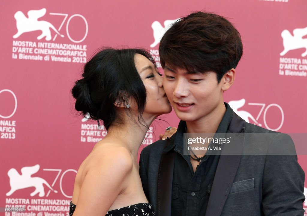 Actress <a gi-track='captionPersonalityLinkClicked' href=/galleries/search?phrase=Lee+Eun-Woo&family=editorial&specificpeople=8599488 ng-click='$event.stopPropagation()'>Lee Eun-Woo</a> and actor Seo Young Ju attend the 'Moebius' Photocall during the 70th Venice International Film Festival at Sala Grande on September 3, 2013 in Venice, Italy.