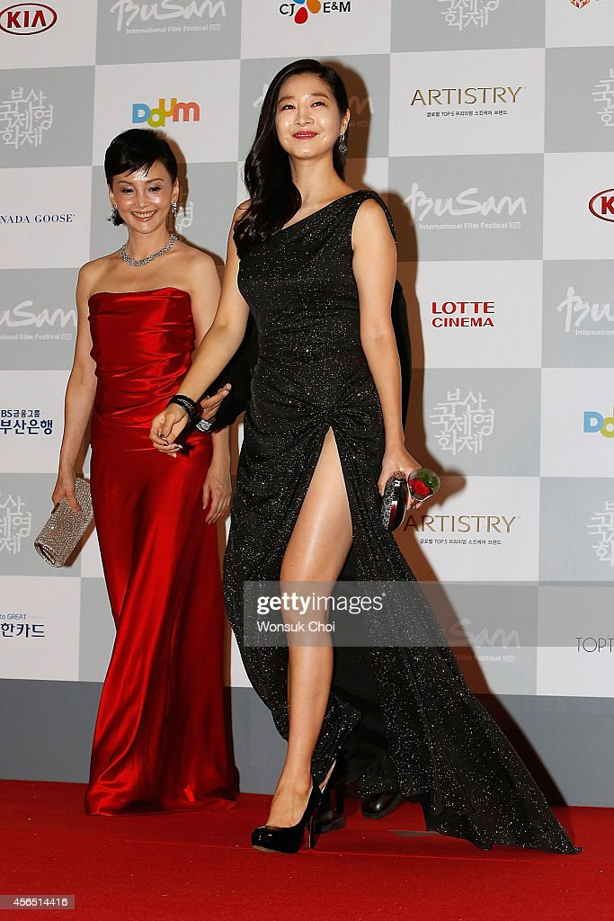 Actress Lee Eun-Woo (R) and Kaho Minami walk on the red carpet during the opening ceremony of the 19th Busan International Film Festival (BIFF) at the Busan Cinema Center on October 2, 2014 in Busan, South Korea.