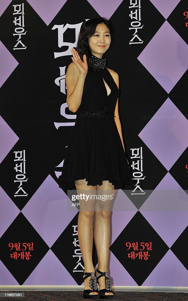 Actress Lee Eun-Woo poses for photographers during the new movie Moebius press conference in Seoul on August 30, 2013. Film director Kim Ki-Duk cut scenes from his incest-themed new movie Moebius after it was effectively banned by domestic censors. Moebius is Kims first film since Pieta which won the coveted Golden Lion award at lats years Venice Film Festival.