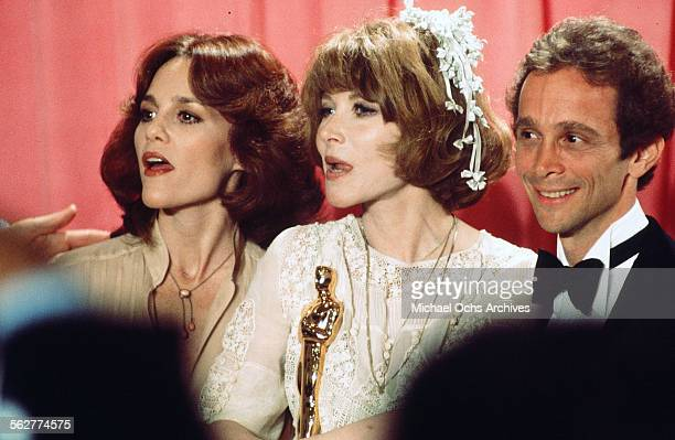 Actress Lee Grant poses backstage after winning ' Best Supporting Actress' with Madeline Kahn and actor Joel Grey during the 48th Academy Awards at...