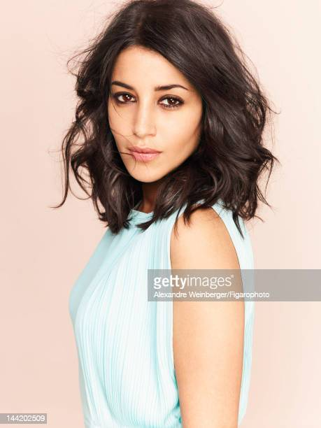 Actress Leila Bekhti is photographed for Madame Figaro on March 26 2012 in Paris France PUBLISHED IMAGE Figaro ID 103574002 Dress by Versace Makeup...