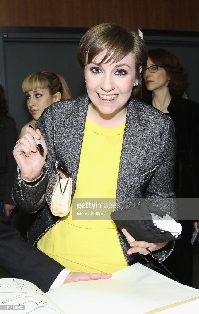 Actress <a gi-track='captionPersonalityLinkClicked' href=/galleries/search?phrase=Lena+Dunham&family=editorial&specificpeople=5836535 ng-click='$event.stopPropagation()'>Lena Dunham</a> poses with the GRAMMY Charities Signing Booth during the 55th Annual GRAMMY Awards at STAPLES Center on February 10, 2013 in Los Angeles, California.