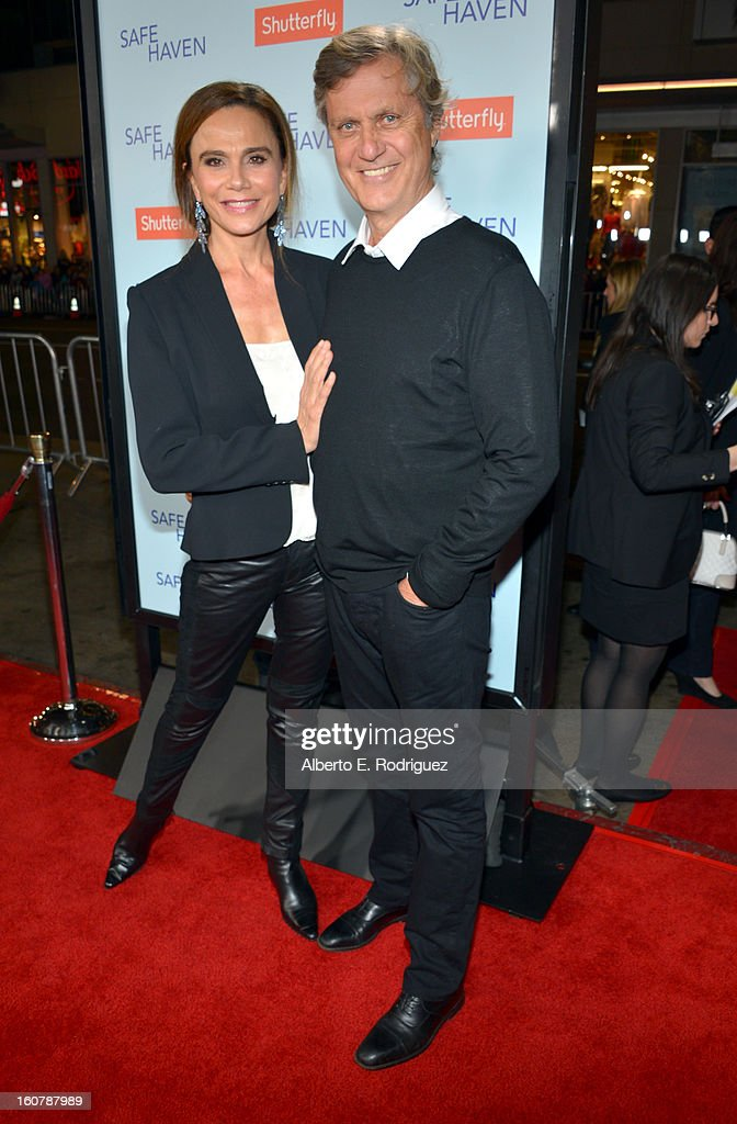 Actress Lena Olin (L) and director Lasse Hallstrom arrive at the premiere of Relativity Media's 'Safe Haven' at TCL Chinese Theatre on February 5, 2013 in Hollywood, California.