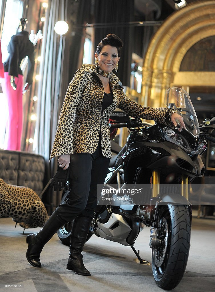 Actress Lesli Kay poses during a photoshoot for designer Lloyd Klein's new motorcycle couture line at Lloyd Klein on July 8, 2010 in Los Angeles, California.