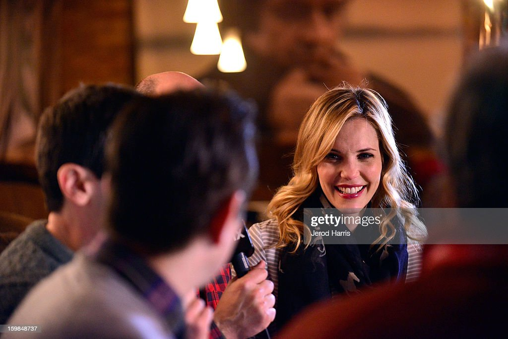 Actress Leslie Bibb warms up at the McDonald's McCafe at Sundance on January 21, 2013 in Park City, Utah.