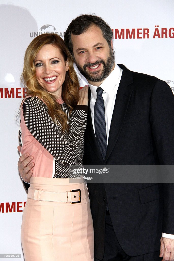 Actress <a gi-track='captionPersonalityLinkClicked' href=/galleries/search?phrase=Leslie+Mann&family=editorial&specificpeople=595973 ng-click='$event.stopPropagation()'>Leslie Mann</a> and her husband and director <a gi-track='captionPersonalityLinkClicked' href=/galleries/search?phrase=Judd+Apatow&family=editorial&specificpeople=854225 ng-click='$event.stopPropagation()'>Judd Apatow</a> attend the 'Immer Aerger mit 40' Berlin photocall at Hotel Adlon on January 30, 2013 in Berlin, Germany.