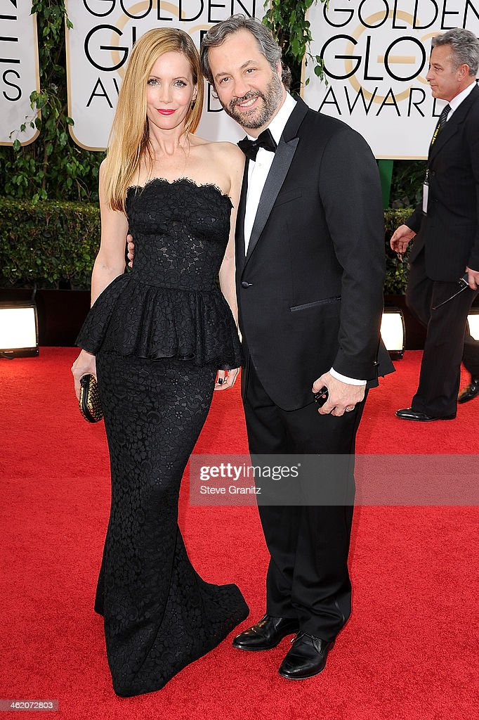 Actress Leslie Mann and producer Judd Apatow attend the 71st Annual Golden Globe Awards held at The Beverly Hilton Hotel on January 12 2014 in...