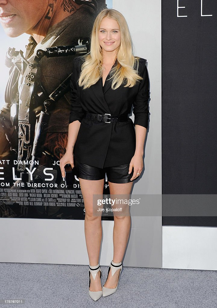 Actress Leven Rambin arrives at the Los Angeles Premiere 'Elysium' at Regency Village Theatre on August 7, 2013 in Westwood, California.