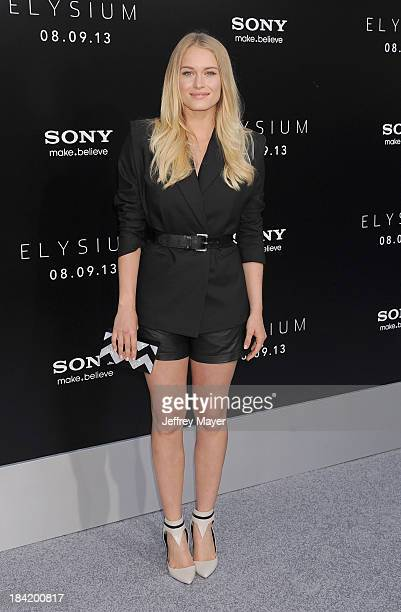 Actress Leven Rambin arrives at the Los Angeles premiere of 'Elysium' at Regency Village Theatre on August 7 2013 in Westwood California