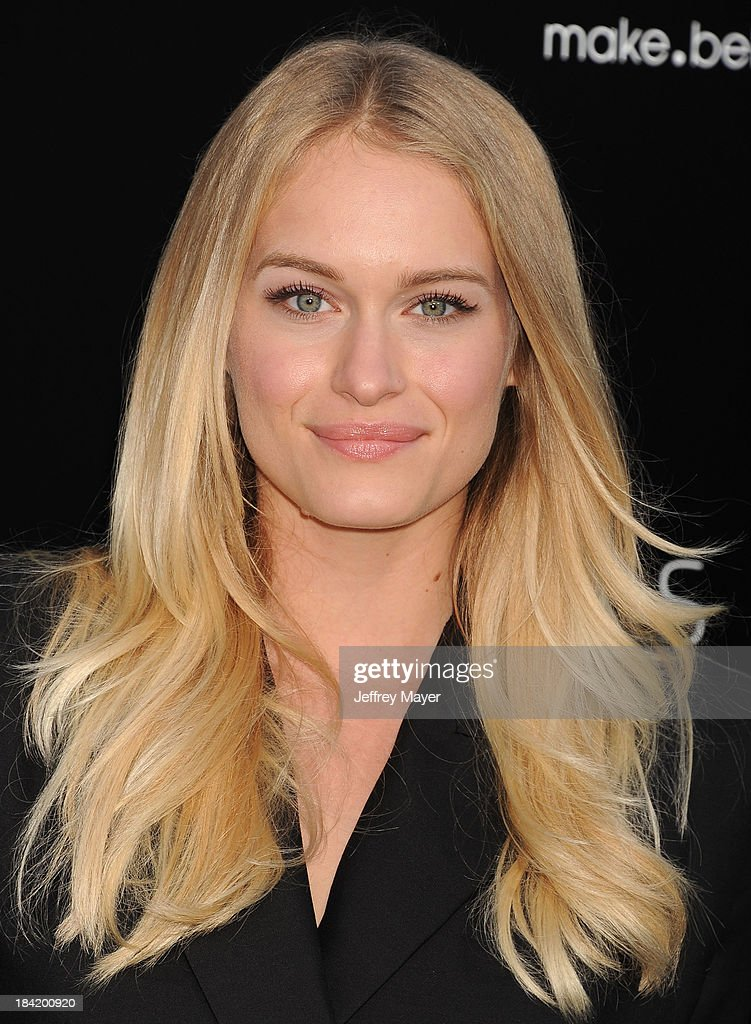 Actress Leven Rambin arrives at the Los Angeles premiere of 'Elysium' at Regency Village Theatre on August 7, 2013 in Westwood, California.