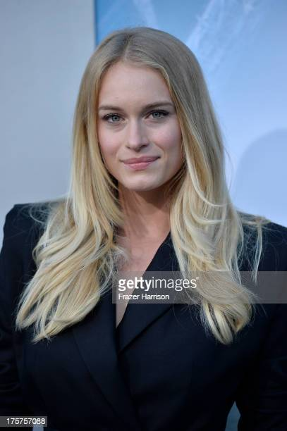 Actress Leven Rambin arrives at the premiere of TriStar Pictures' 'Elysium' at Regency Village Theatre on August 7 2013 in Westwood California