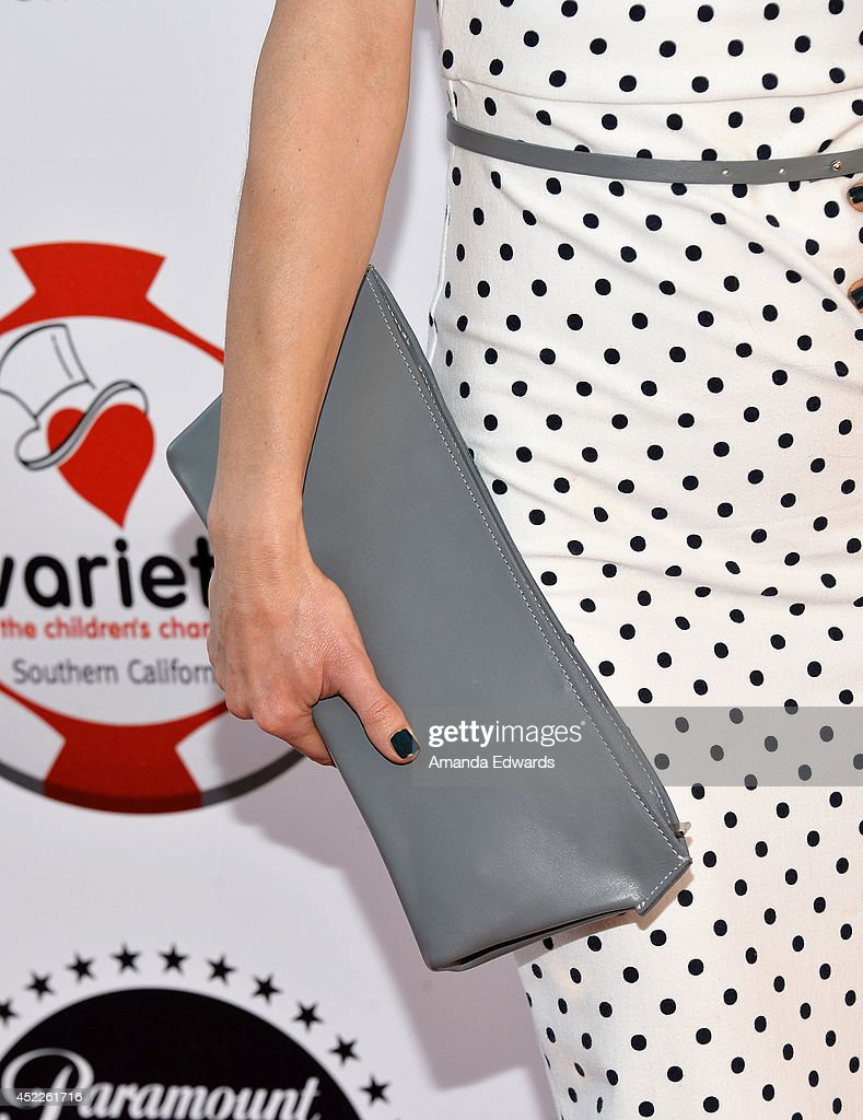 Actress Lili Bordan (clutch detail) arrives at the 4th Annual Variety - The Children's Charity of Southern CA Texas Hold 'Em Poker Tournament at Paramount Studios on July 16, 2014 in Hollywood, California.