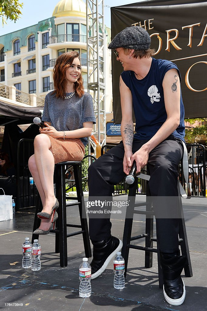 Actress <a gi-track='captionPersonalityLinkClicked' href=/galleries/search?phrase=Lily+Collins&family=editorial&specificpeople=3520243 ng-click='$event.stopPropagation()'>Lily Collins</a> (L) and actor <a gi-track='captionPersonalityLinkClicked' href=/galleries/search?phrase=Jamie+Campbell+Bower&family=editorial&specificpeople=4586724 ng-click='$event.stopPropagation()'>Jamie Campbell Bower</a> attend 'The Mortal Instruments: City Of Bones' meet and greet at The Americana at Brand on August 13, 2013 in Glendale, California.