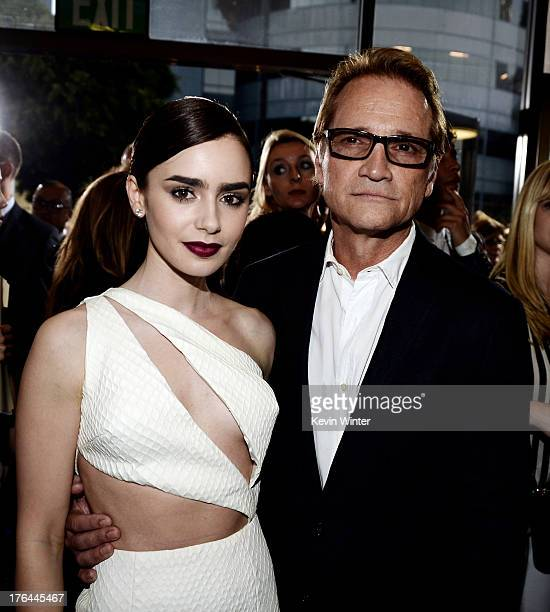 Actress Lily Collins and Clint Culpepper President Screen Gems arrive at the premiere of Screen Gems Constantin Films' 'The Mortal Instruments City...