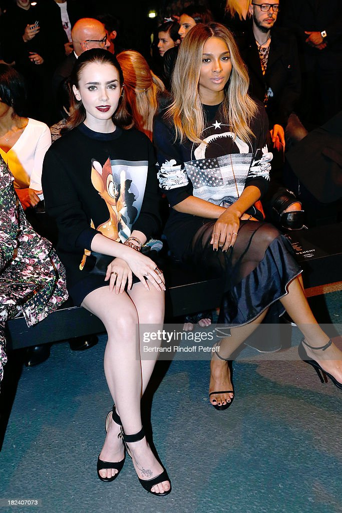 Actress <a gi-track='captionPersonalityLinkClicked' href=/galleries/search?phrase=Lily+Collins&family=editorial&specificpeople=3520243 ng-click='$event.stopPropagation()'>Lily Collins</a> and singer Ciara attend Givenchy show as part of the Paris Fashion Week Womenswear Spring/Summer 2014, held at 'la Halle Freyssinet' on September 29, 2013 in Paris, France.
