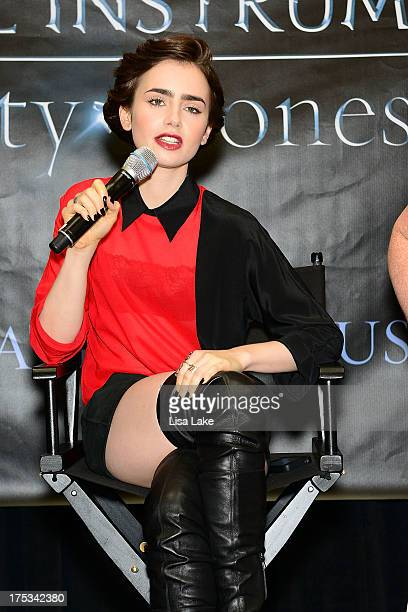 Actress Lily Collins answers questions during QA for fans at the Franklin Mills Mall in anticipation for Screen Gems' actionfantasy THE MORTAL...