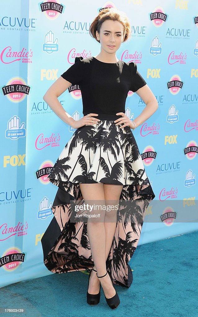 Actress Lily Collins arrives at the 2013 Teen Choice Awards at Gibson Amphitheatre on August 11, 2013 in Universal City, California.