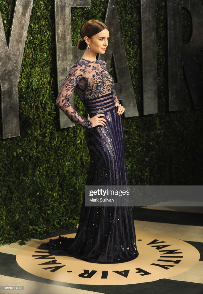 Actress Lily Collins arrives at the 2013 Vanity Fair Oscar Party at Sunset Tower on February 24, 2013 in West Hollywood, California.