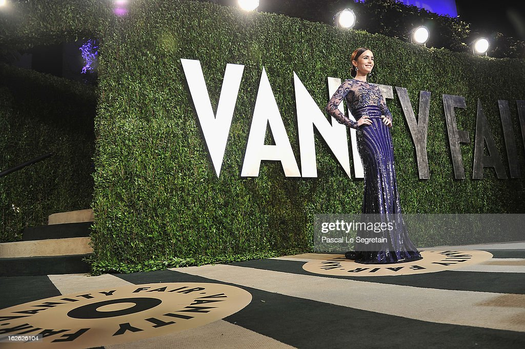 Actress Lily Collins arrives at the 2013 Vanity Fair Oscar Party hosted by Graydon Carter at Sunset Tower on February 24, 2013 in West Hollywood, California.
