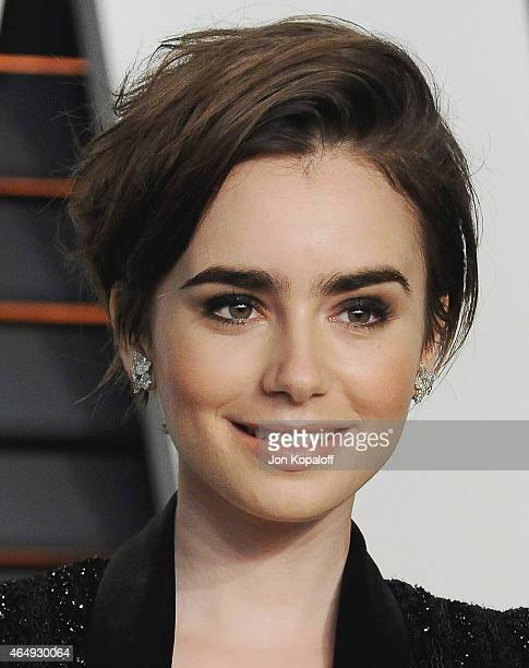 Actress Lily Collins arrives at the 2015 Vanity Fair Oscar Party Hosted By Graydon Carter at Wallis Annenberg Center for the Performing Arts on...