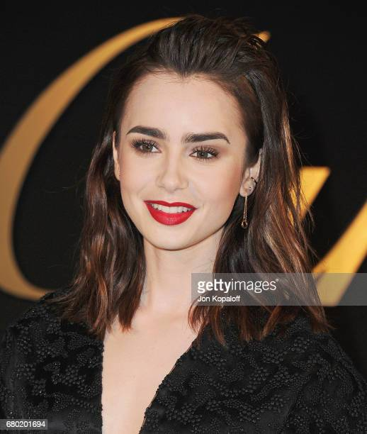 Actress Lily Collins arrives at the Panthere De Cartier Party In LA at Milk Studios on May 5 2017 in Los Angeles California