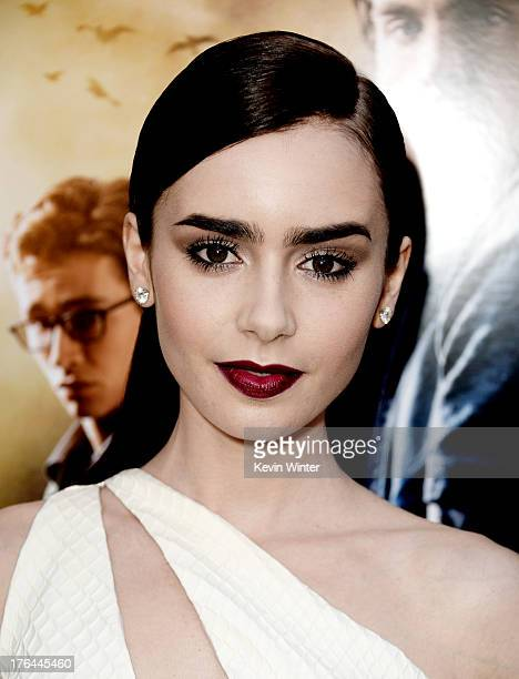 Actress Lily Collins arrives at the premiere of Screen Gems Constantin Films' 'The Mortal Instruments City Of Bones' at the Cinerama Dome Theatre on...