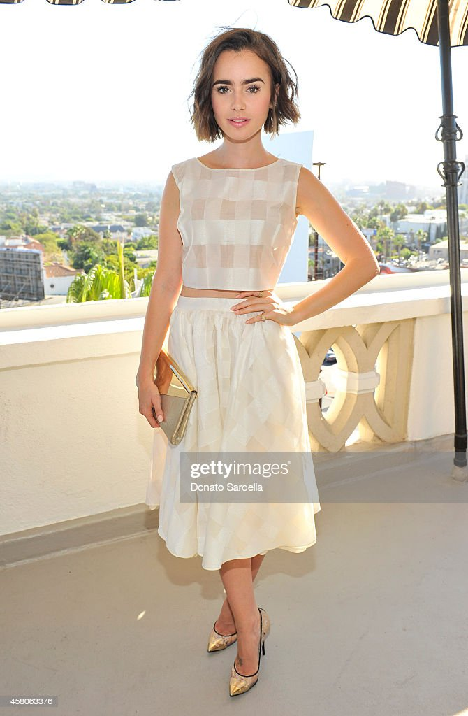 Actress <a gi-track='captionPersonalityLinkClicked' href=/galleries/search?phrase=Lily+Collins&family=editorial&specificpeople=3520243 ng-click='$event.stopPropagation()'>Lily Collins</a> at Eddie Redmayne, Vanity Fair And Burberry Celebrate BAFTA Los Angeles and the Britannia Awards at Chateau Marmont on October 29, 2014 in Los Angeles, California.