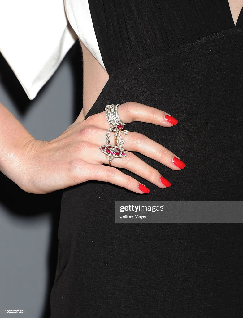 Actress Lily Collins (rings detail) at the 15th Annual Costume Designers Guild Awards at The Beverly Hilton Hotel on February 19, 2013 in Beverly Hills, California.