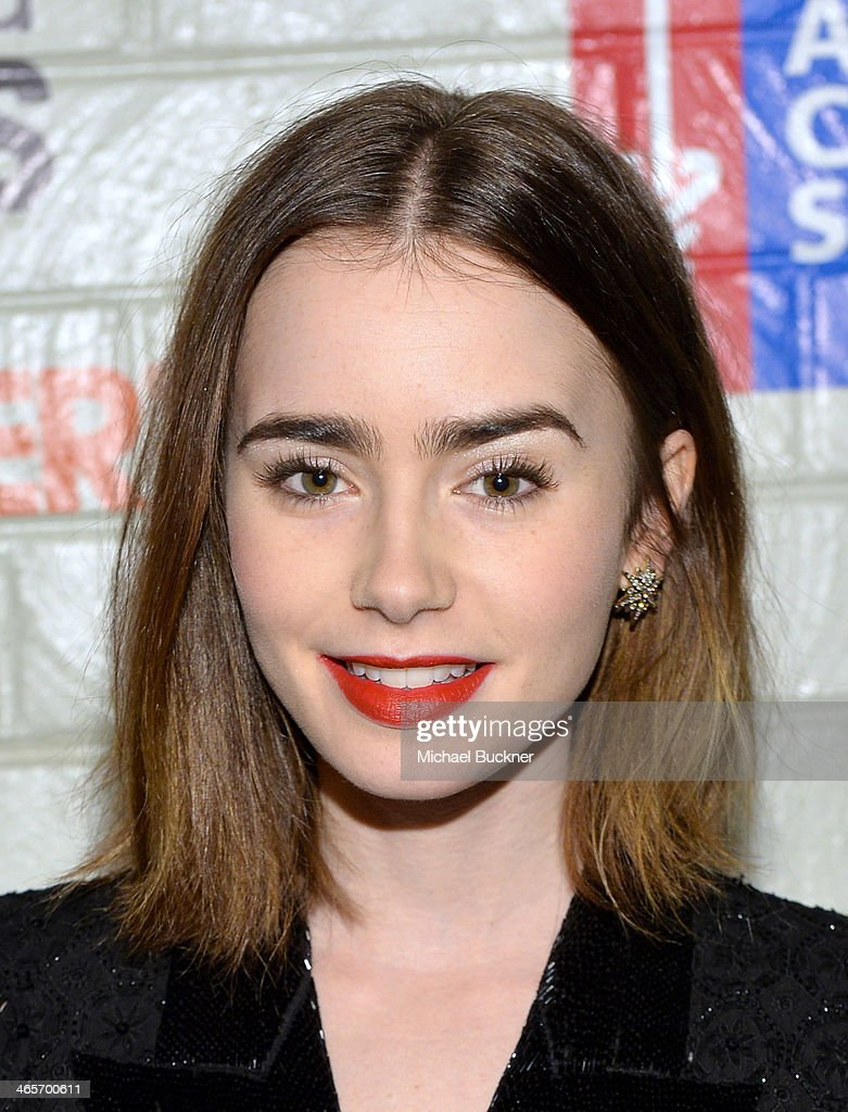 Actress Lily Collins attends Hollywood Stands Up To Cancer Event with contributors American Cancer Society and Bristol Myers Squibb hosted by Jim Toth and Reese Witherspoon and the Entertainment Industry Foundation on Tuesday, January 28, 2014 in Culver City, California.