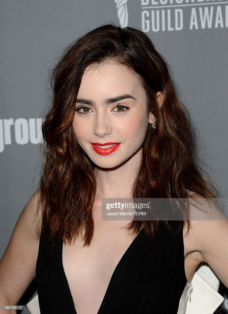 Actress Lily Collins attends the 15th Annual Costume Designers Guild Awards with presenting sponsor Lacoste at The Beverly Hilton Hotel on February 19, 2013 in Beverly Hills, California.